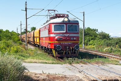 52 0043 leads a loaded coal train over the level crossing near Kopanitsa for Bobov Dol Power Station. Friday 8th July 2016.