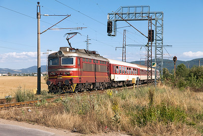 44 098 passes the level crossing at Zhivkovo with train 8602 08.50 Burgas to Sophia. Thursday 7th July 2016.