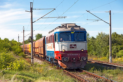 New private operator TBD's 60 0819 (Ex CFR) brings a loaded coal train over the level crossing near Kopanitsa heading for Bobov Dol Power Station. Friday 8th July 2016.