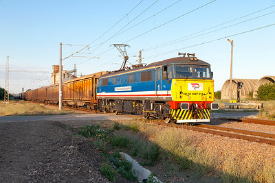 87012 passes the level crossing at Tserkovski west of Karnobat with a mixed freight for Pirdop in the last of the evening light. Tuesday 5th July 2016.