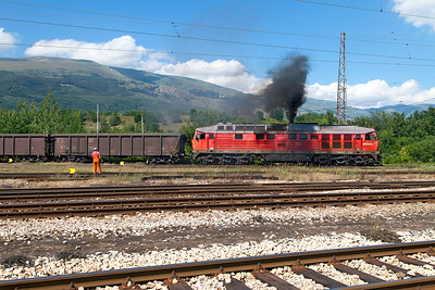 A very sick Ludmilla 232 678 shunts copper ore wagons at Pirdop Yard. Monday 4th July 2016.