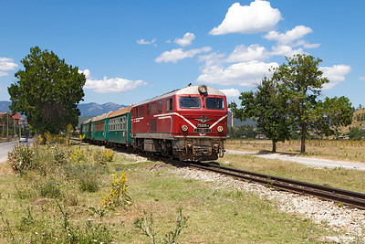 Narrow Gauge Henschel 75 005 heads away from the station stop at Velingrad with train 16105 13.20 Septemvri to Dobriniste. Thursday 7th July 2016.