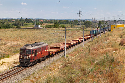 06 111 heads a mixed freight away from the new yard at Slivengrad and heads west along the upgraded line between the Turkish border and Dimitrovgrad. Wednesday 6th July 2016.