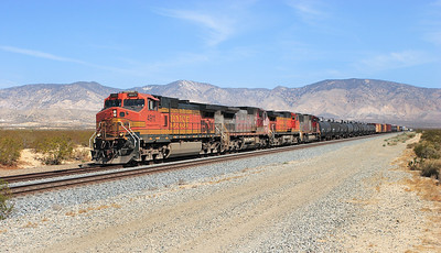 BNSF 4911 (C44-9W), BNSF 575 (B40-8W), BNSF 5464 (C44-9W) & BNSF 8215 (SD75M) approach Mojave with a southbound manifest working. Sunday 29th April 2007.