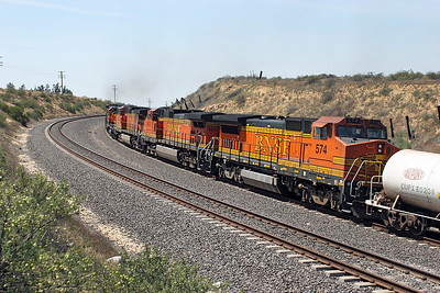BNSF 5473 (C44-9W), BNSF 2965 (GP39-2R), BNSF (GP38-2), BNSF 4325 (C44-9W), BNSF 4570 (C44-9W) & BNSF 574 (B40-8W) leading the westbound manifest at Sandcut are seen heading away towards Bakersfield. Saturday 28th April 2007.