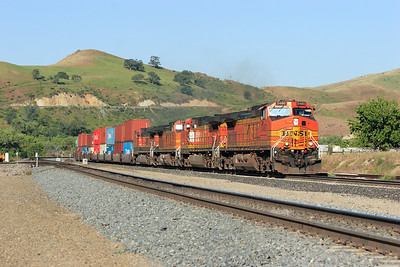 BNSF 5480; 4476; 5339 & 1078 (all C44-9W's) wait in the siding at Caliente with an east bound double stack train. After the crossing meet they will head round the horseshoe and climb the track in the background above their train. Friday 27th April 2007.