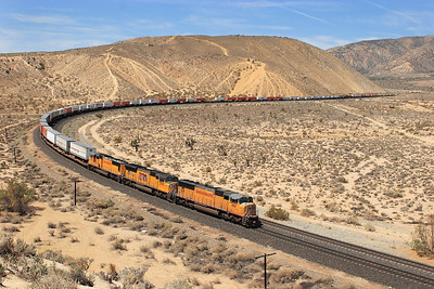 UP 4114, UP 3798 & UP 4562 (all SD70M's) sweep round the curve at Warren with a southbound Intermodal on the downhill stretch to Mojave. 29/04/2011.