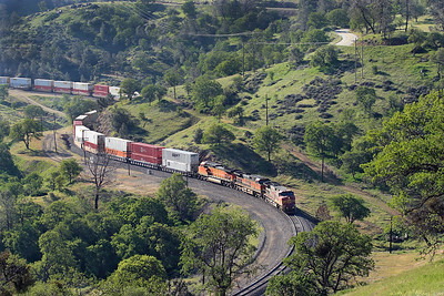 War Bonnet liveried BNSF 623  along with BNSF 1087 & BNSF 5516 (all C44-9W's) bring a westbound double stack train through the S curve approaching Tunnel 10 before entering Tehachapi Loop. 28/04/2007.