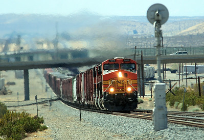 BNSF 7669 (ES44DC), BNSF 1120 (C44-9W) & BNSF 7707 (ES44DC) in a mixture of heat haze from the desert and their own exhaust start the climb away from the Mojave Sink and head for the summit at Tehachapi. Sunday 29th April 2007.