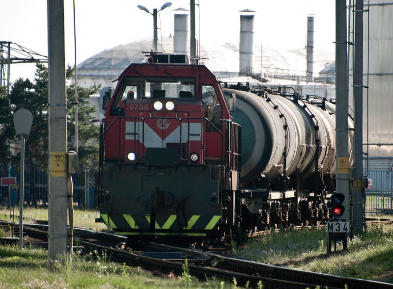 A shunter negotiates the points out of the oil terminal in the northern docks.<br /> <br /> 29th July 2017