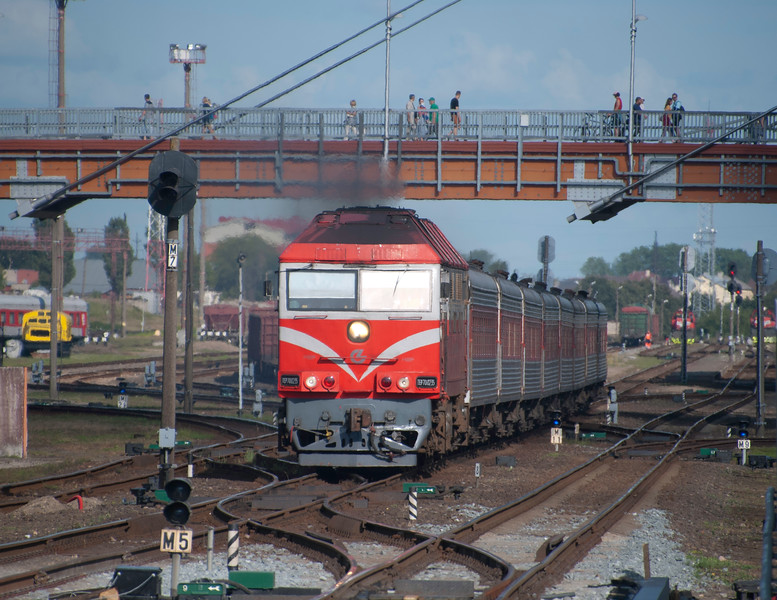 TEP 70 0235 blasts out of Klaipeda station up on the start of its journey to Vilnius.<br /> <br /> 29th July 2017