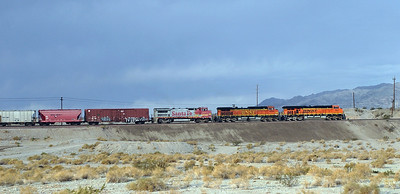 BNSF 7607 (ES44DC), BNSF 4560 (C44-9W) & BNSF 542 (B40-8W) climb out of Needles with a westbound manifest train. Seen from the hotel balcony. Tuesday 1st. May 2007.