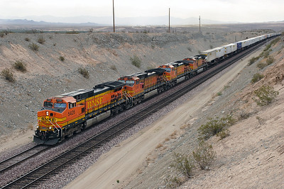 BNSF 5426, BNSF 5249, BNSF 4638 & BNSF 4972 (all C44-9W's) running elephant style with a westbound intermodal passing Park Moabi Road overbridge at Topock approaching Needles. 01/05/2007.