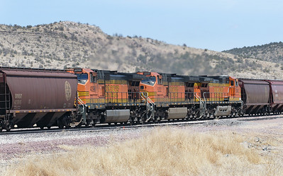 BNSF 4096, BNSF 5222 & BNSF 5342 (all C44-9W's) mid train helpers on the westbound loaded grain train passing Peach Springs. 02/05/2007.