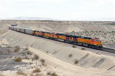 BNSF 4764, BNSF 4978, BNSF 4300 & BNSF 4623 (all C44-9W's) head east away from Needles and approach Topock at the Park Moabi Road overbridge with a trailing load of Autoracks. 01/05/2007.