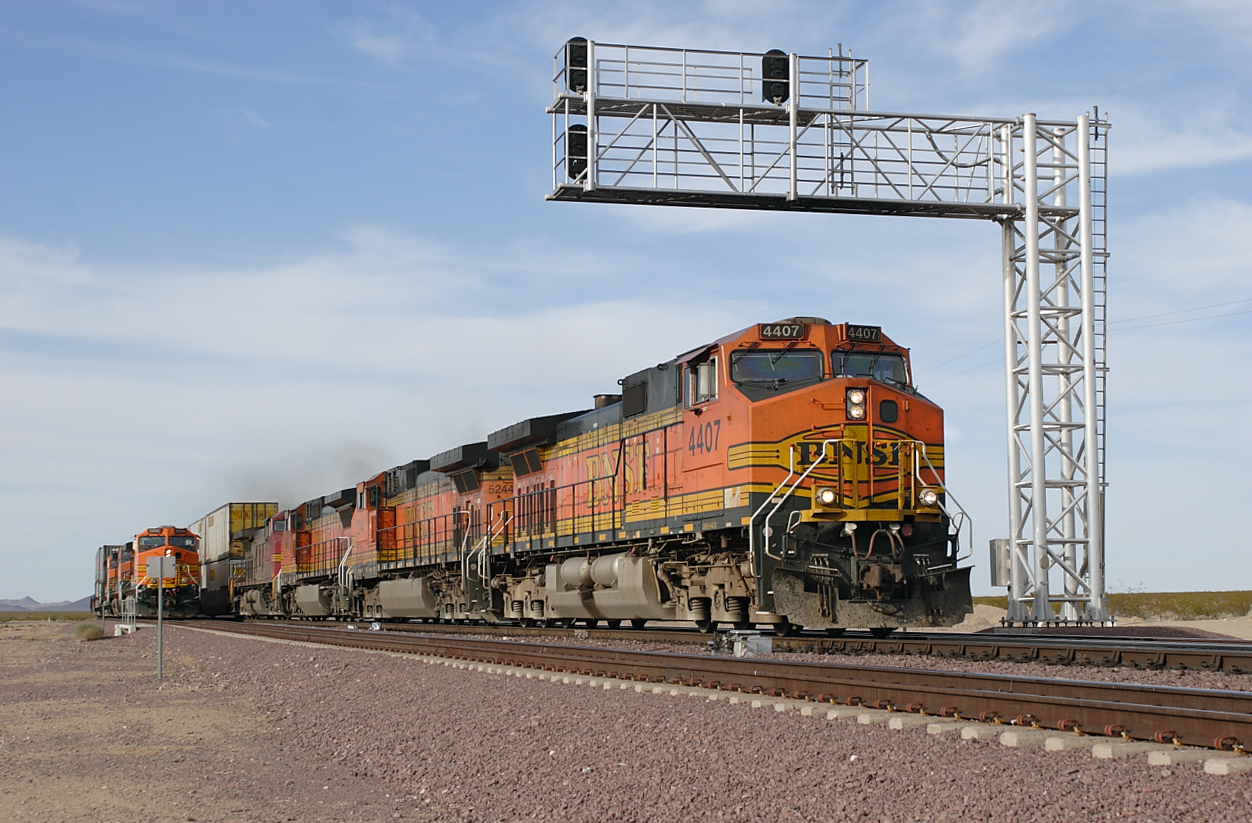 BNSF 4407, BNSF 5244 (both C44-9W's), BNSF 845 (C40-8W) & BNSF 733 (C44-9W) overtake BNSF 5060, BNSF 1034 & BNSF 4918 (all C44-9W's) both westbound doublestack trains at West Goffs. 30/04/2007.
