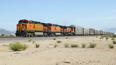 BNSF 5439, BNSF 4134 (both C44-9W's) & BNSF 913 (C40-8W) pass the airfield east of Kingman with westbound autoracks. 02/05/2007.