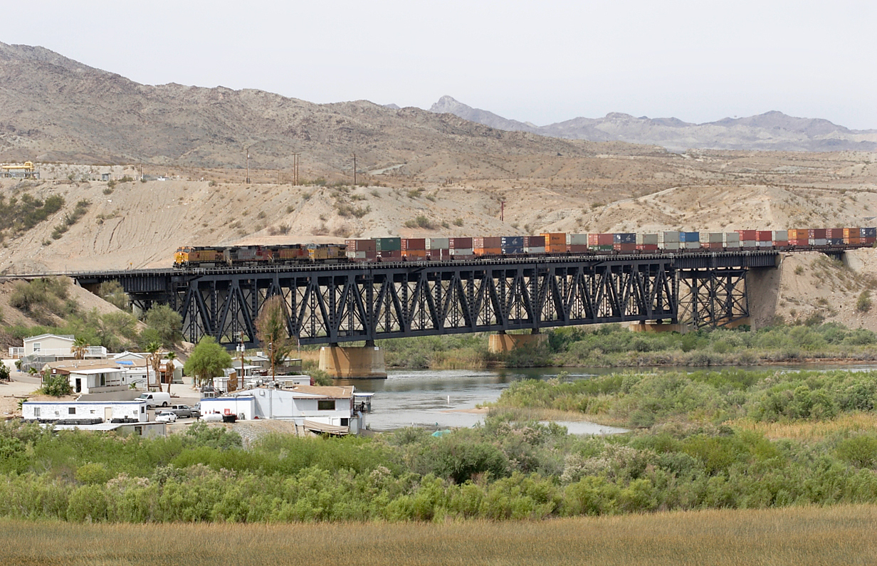 BNSF 5396, BNSF 746 (both C44-9W's), BNSF 5852 (ES44AC) & UP 5999 (C44ACCTE) cross the state line on the Colorado River bridge at Topock with an eastbound doublestack train. 01/05/2007.