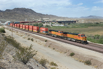BNSF 4666 & BNSF 4092 (both C44-9W's) have their eastbound doublestack train strung out over the Colorada River bridge at Topock. The front of the train is in Arizona whilst the rear is still in Calfornia. Tuesday 1st May 2007.