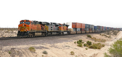BNSF 7723 (ES44DC), KCS 4000 (SD70ACE) & BNSF 4372 (C44-9W) head a westbound doublestack at Yucca. 01/05/2007.