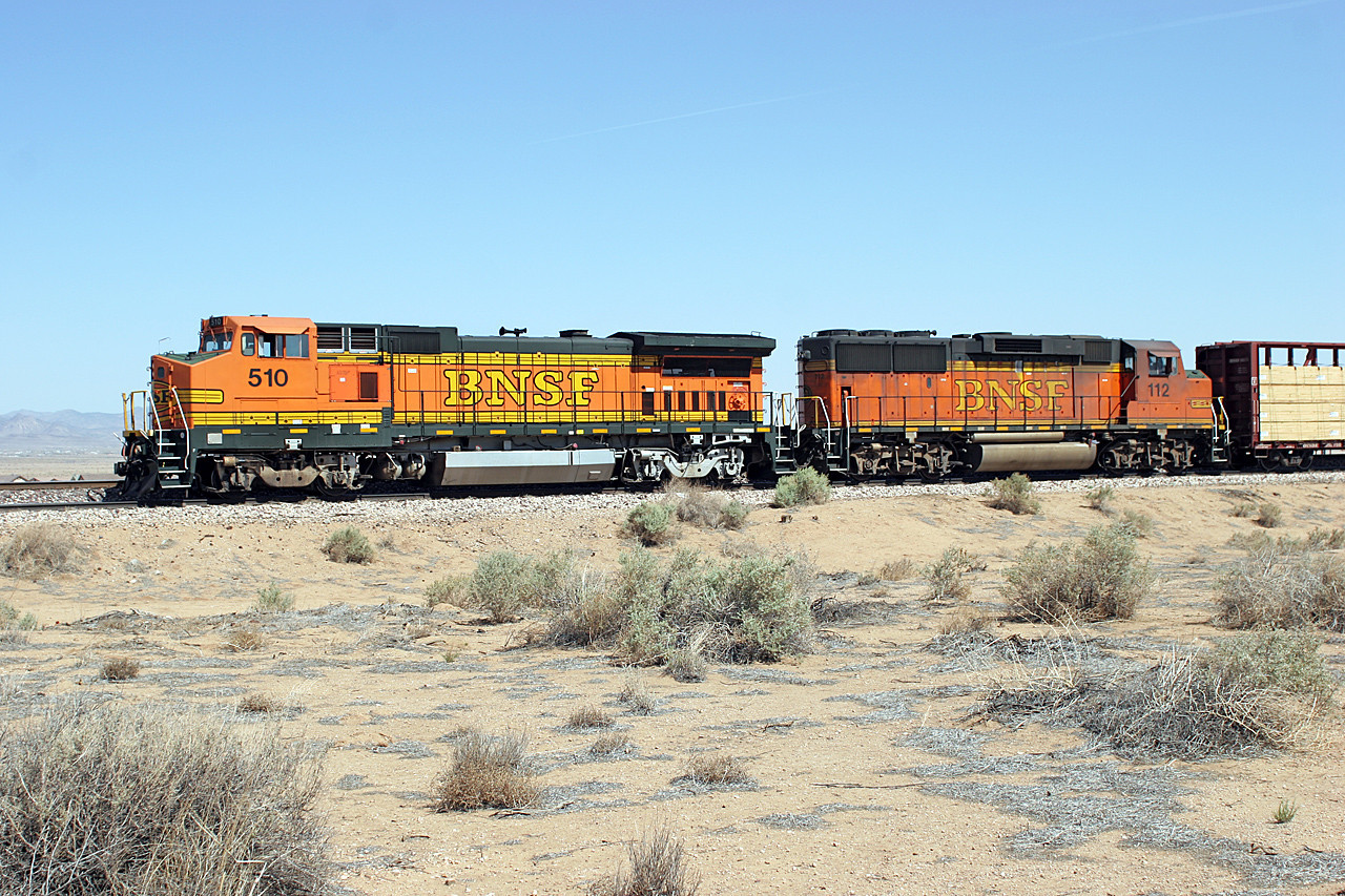 BNSF 510 (B40-8W) & BNSF 112 (GP60M) are engaged in switching duties east of Kingman. 02/05/2007.