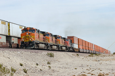 BNSF 4688, BNSF 5400, BNSF 4778 (all C44-9W's) & CN 5741 SD75IW) power a westbound hotshot doublestack train and overtake another doublestack train at Bagdad. 30/04/2007.