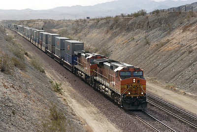 BNSF 5020 & BNSF 4663 (both C44-9W's) pass Park Moabi Road, Topock with a westbound doublestack train. 01/05/2007.