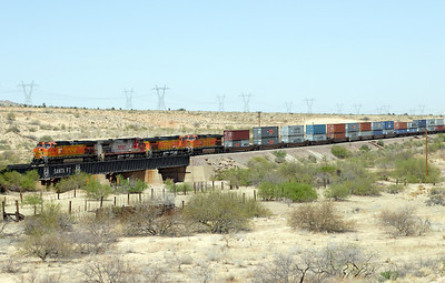 BNSF 4939, BNSF 729, BNSF 4303 & BNSF 5273 (all C44-9W's) cross a wash near Hackberry with an eastbound doublestack train. The bridge stiil has Santa Fe on the side, one of only two on this section of the Transcon. 02/05/2007.