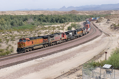 BNSF 5194, BNSF 610 (both C44-9W's), NS 9678 (C40-9W), BNSF 6338 (SD40-2) & BNSF 930 (C40-8W) westbound doublestack train approaching the Colorado River bridge at Topock. 01/05/2007.