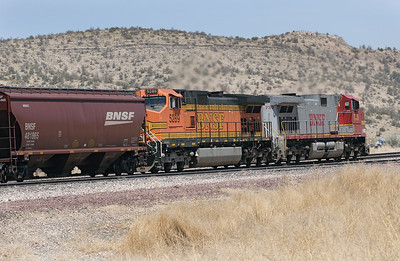 BNSF 5289 & BNSF 730 (both C44-9W's) are the rear end helpers on the westbound loaded grain train passing Peach Springs. 02/05/2007.