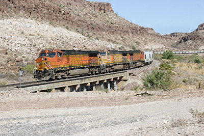 BNSF 5208, BNSF 4522 & BNSF 4862 (all C44-9W's) cross the wash towards the bottom of Kingman Canyon with a westbound manifest train comprised mainly of cement wagons. Wednesday 2nd May 2007.