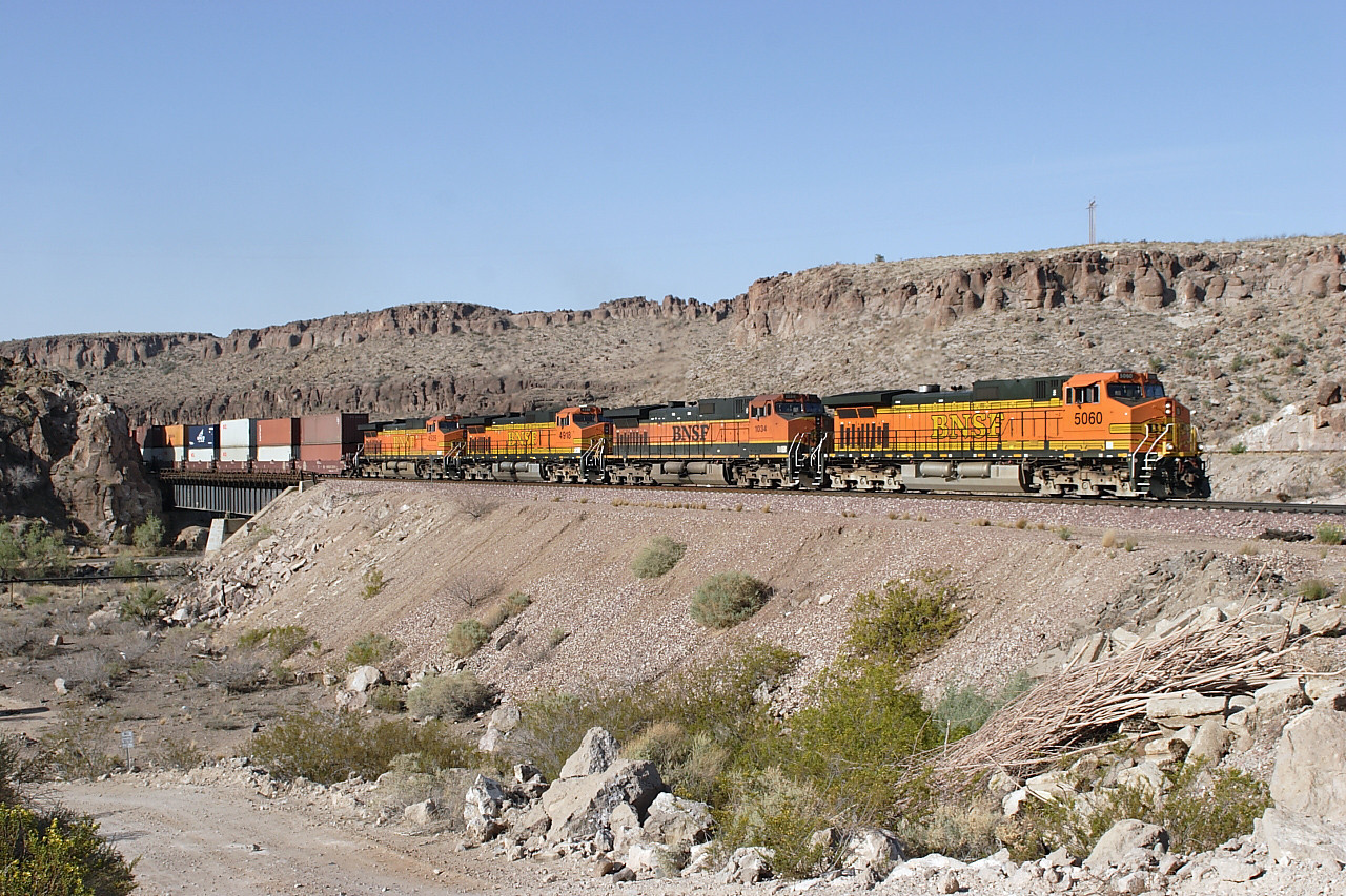 BNSF 5060, BNSF 1034, BNSF 4918 & BNSF 4535 (all C44-9W's) travelling elephant style are nearly at the top of the climb in Kingman Canyon with an eastbound doublestack train. Wednesday 2nd May 2007.