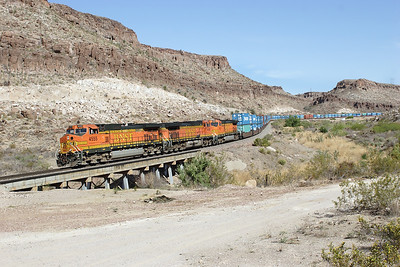 BNSF 4555, BNSF 4438, BNSF 4029 (all C44-9W's) wind down Kingman Canyon with a westbound doublestack train. 02/05/2007.