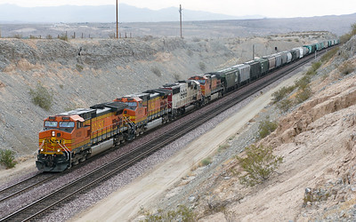 BNSF 4123, BNSF 4774 (both C44-9W's), CEFX 6003 (SD60) & BNSF 4101 (C44-9W) head a westbound manifest train under Park Moabi Road bridge, Topock. 01/05/2007.