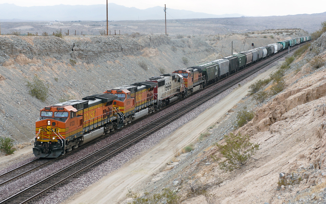 BNSF 4123, BNSF 4774 (both C44-9W's), CEFX 6003 (SD60) & BNSF 4101 (C44-9W) head a westbound manifest train under Park Moabi Road bridge, Topock. 01/05/2007.