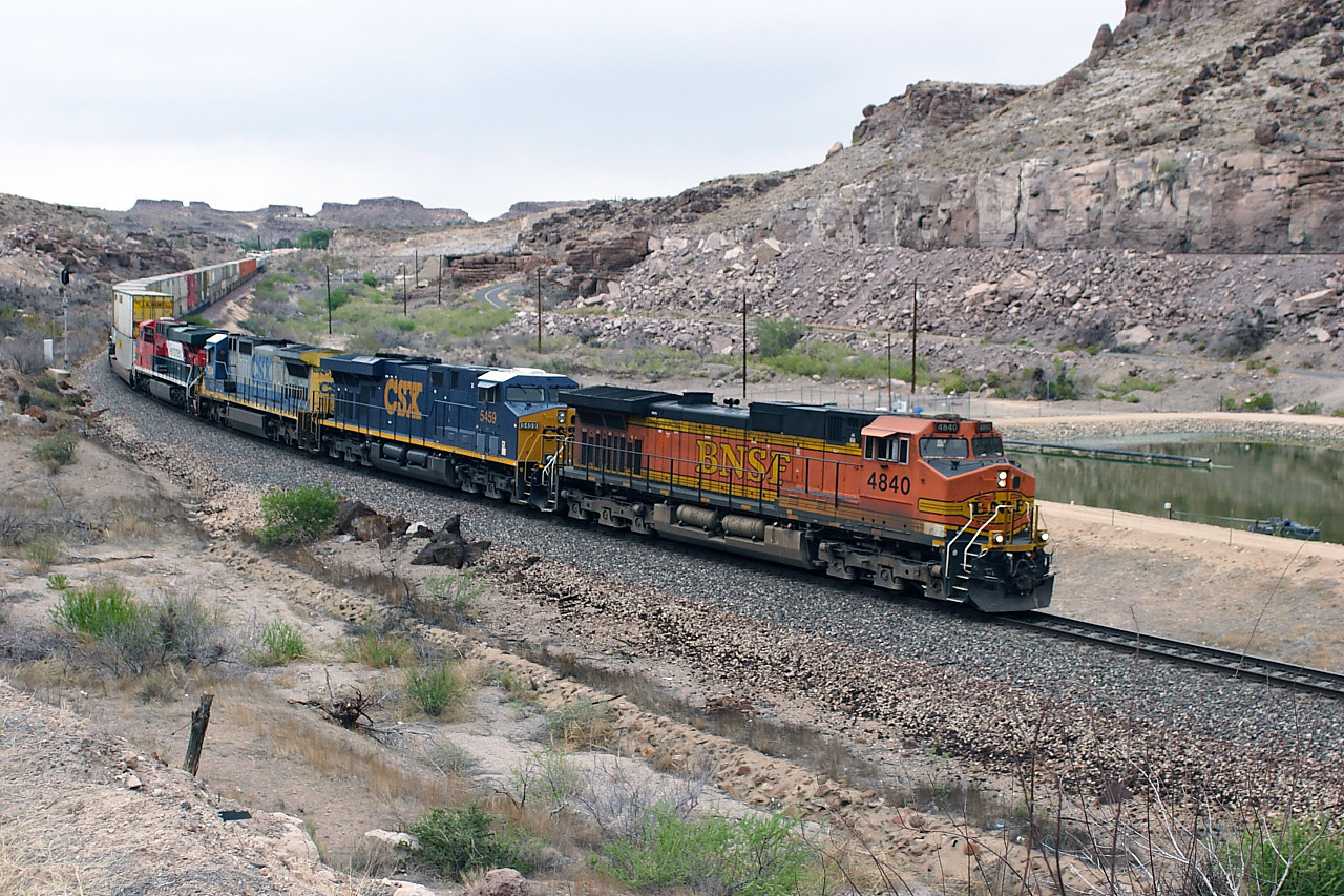 BNSF 4840 (C44-9W), CSX 5459 (ES44DC), CSX 7504 (C40-8) & FERROMEX 4630 (ES44AC) are on the lower track decending Kingman Canyon with a westbound doublestack/intermodal working. 01/05/2007.