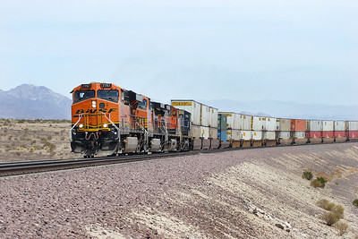 BNSF 7767 (ES44DC), BNSF 4992, BNSF 1036 & CSX 9027 (all C44-9W's) westbound doublestack train passing Bagdad, Monday 30th April 2007.