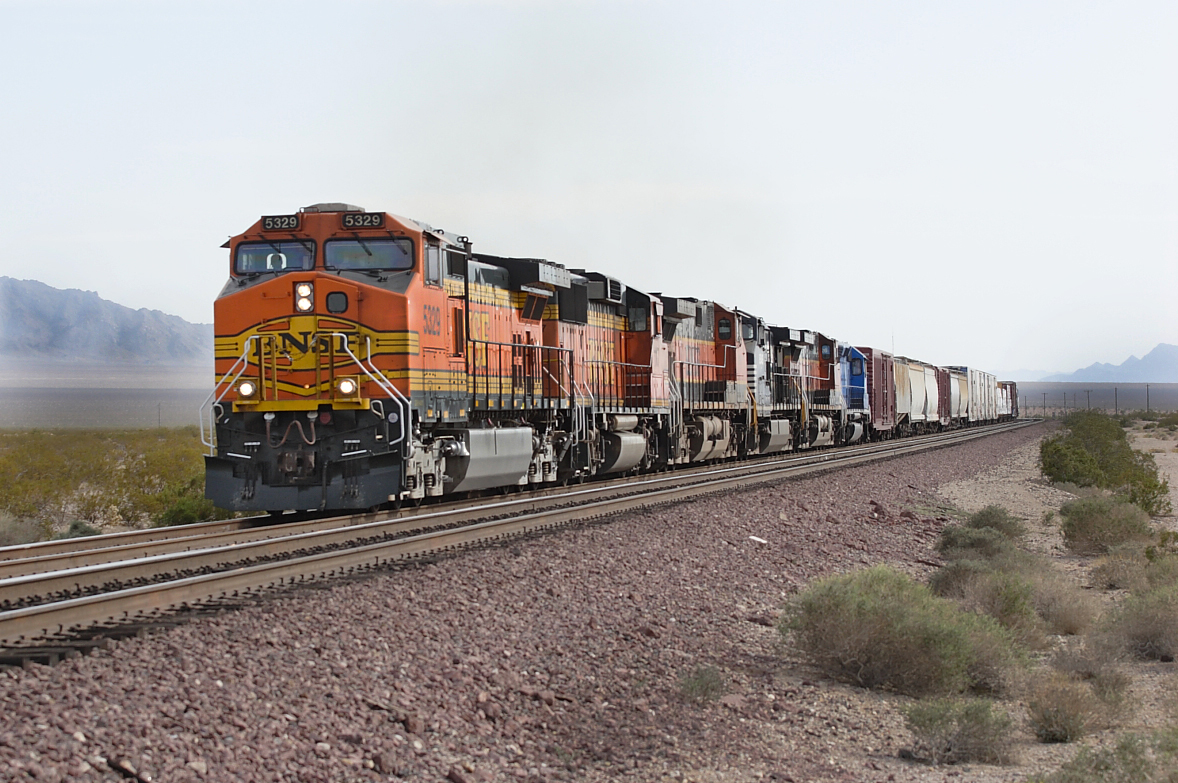 BNSF 5329 (C44-9W), BNSF 117 (GP60M), BNSF 998 (C44-9W), NS 8949 (C40-9W), BNSF 1049 (C44-9W) & CEFX 3126 (SD40M-2) pass Fenner with an eastbound manifest train. 30/04/2007.