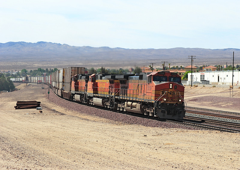 BNSF 5159, BNSF 4517 & BNSF 5250 (all C44-9W's) approach Barstow from the east with a mixed doublestack and intermodal working. Monday 30th April 2007.
