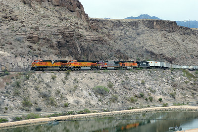 BNSF 4745, BNSF 4583 (both C44-9W's), BNSF 800 (C40-8W), BNSF 4071 (C44-9W) & NS 9708 (C40-9W) climb through Kingman Canyon with an eastbound intermodal. 4745 seems to have been a recent fire victim. 01/05/2007.