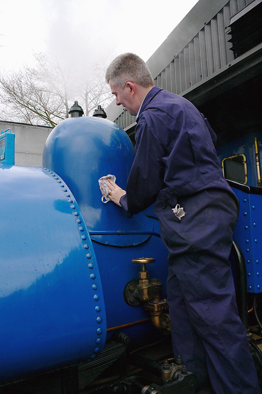 """Something of a """"Railwayman's Holiday"""" for Mark Edlington, former Operations Manager for the now sadly defunct Wrexham & Shropshire Railway, as he applies some wax polish and elbow grease to the dome cover on No. 19. 11:20, Friday 2nd April 2010. Digital Image No. GMPI4860."""
