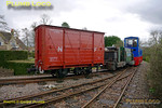"Hunslet 0-4-0DM ""Col. Frederick Wylie"" doing some preliminary shunting at the depot, Beeches Light Railway, owner Adrian Shooter at the controls. Ruston loco ""Wing Cdr. Bertie Billings"" is next to the Hunslet loco, plus a delightful four wheel boxvan. 10:14, Friday 2nd April 2010. Digital Image No. GMPI4788."