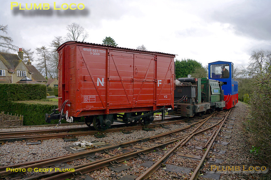 """Hunslet 0-4-0DM """"Col. Frederick Wylie"""" doing some preliminary shunting at the depot, Beeches Light Railway, owner Adrian Shooter at the controls. Ruston loco """"Wing Cdr. Bertie Billings"""" is next to the Hunslet loco, plus a delightful four wheel boxvan. 10:14, Friday 2nd April 2010. Digital Image No. GMPI4788."""