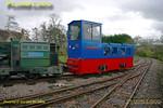"Hunslet 0-4-0DM ""Col. Frederick Wylie"" doing some preliminary shunting at the depot, Beeches Hill Railway, owner Adrian Shooter at the controls. Simplex (?) loco ""Wing Cdr. Bertie Billings"" is next to the Hunslet loco. 10:14, Friday 2nd April 2010. Digital Image No. GMPI4790."