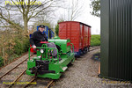"""Adrian Shooter continues to do some shunting, this time using the Simplex diesel, """"Major Gerald Scott"""", having just left the station area. The Hunslet waits with the passenger stock in the background. 11:03, Friday 2nd April 2010.Digital Image No. GMPI4845."""
