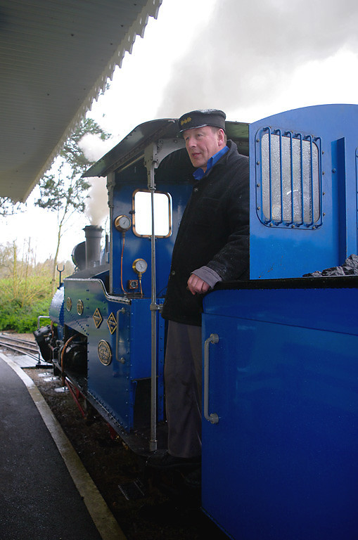 In somewhat wet conditions, Driver Adrian Shooter waits to start the next run around the line at Ringkingpong station. 14:09, Friday 2nd April 2010. Digital Image No. GMPI4945.