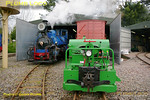 "DHR No. 19 is gently letting off steam just prior to going off shed, while the Simplex diesel ""Major Gerald Scott"" is being used to shunt stock around in the depot area of the Beeches Light Railway. 11:05, Friday 2nd April 2010.Digital Image No. GMPI4851."