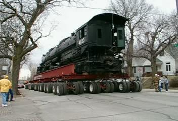 <font size=3>Video - The fellow on the left is raising a wire to clear the tall locomotive.</font><br><br>You may need to click on the image to start the video.