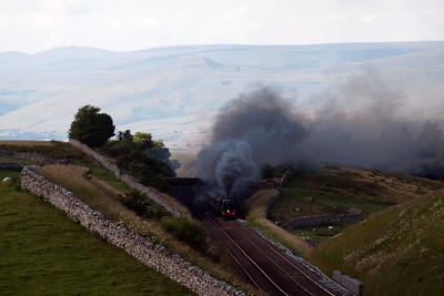 45407 The Lancashire Fusilier blackens the sky across Mallerstang as she digs in to the climb to Ais Gill, having stopped for water at Appleby.