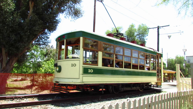 Pacific Electric Birney Safety Car No. 332 - painted as Tucson 10 - returns from a run to Perris on the Orange Empire Railway Museum's main line, 5-13-12. That grade crossing sports 3 wigwags: two in cages and one inverted.